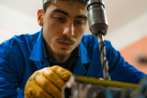 mechanic doing work with columned drill close-up - pillar drill stock photos and pictures