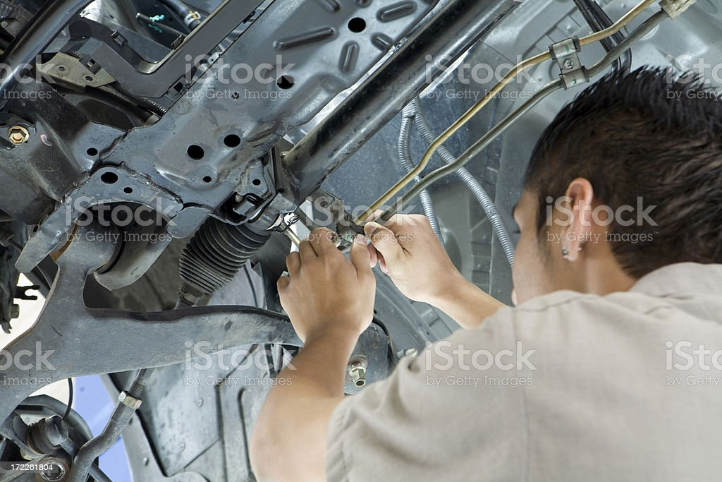 Mechanic Fixing a Car royalty-free stock photo