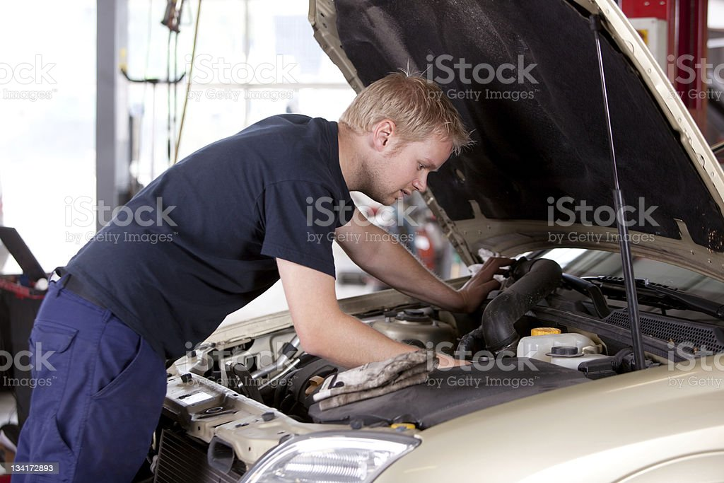 Mechanic fixing old car engine stock photo