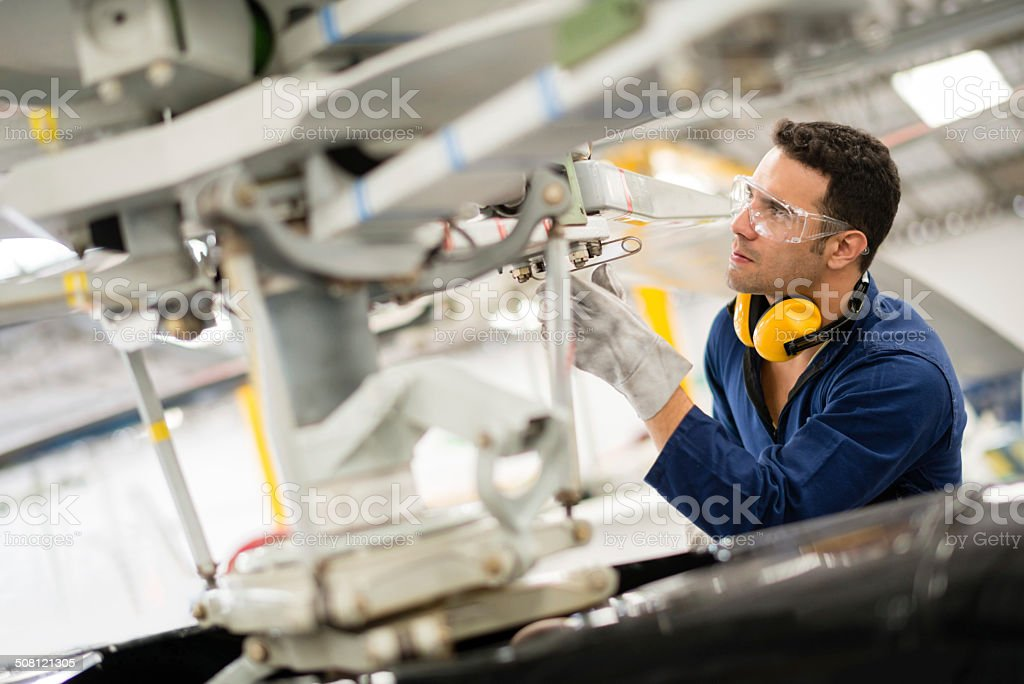 Mechanic fixing the propeller stock photo