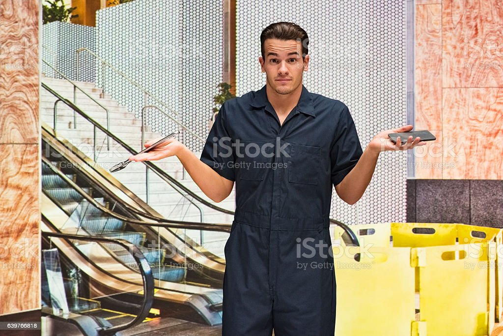 Mechanic gesturing in office stock photo