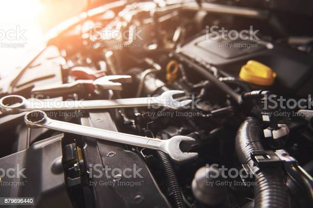 Mechanic hand checking and fixing a broken car in car service garage picture id879696440?b=1&k=6&m=879696440&s=612x612&h=k3kj4doie0bqvszbabw4abjluu4g00bjqoqy8wcv5ey=