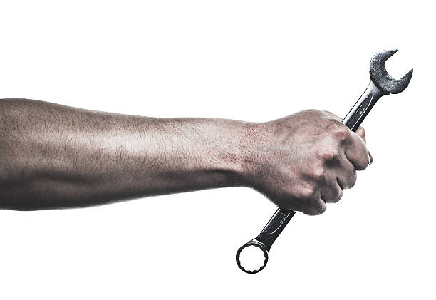 Mechanic hand hold spanner tool in hand stock photo