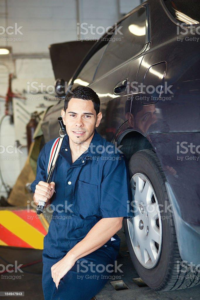 Mechanic holding a ratchet royalty-free stock photo