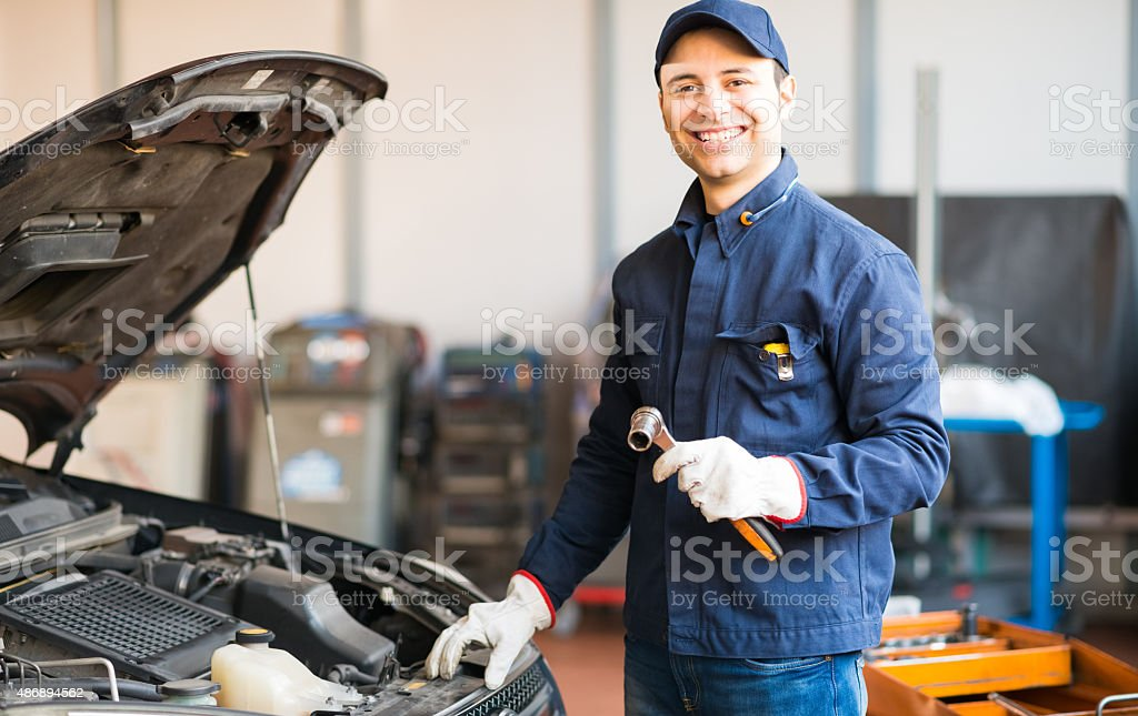 Mechanic holding a wrench stock photo