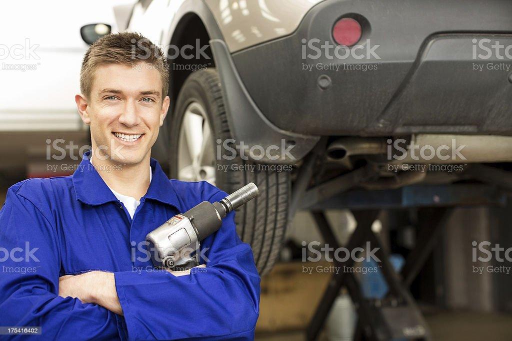 Mechanic Holding Pneumatic Wrench royalty-free stock photo