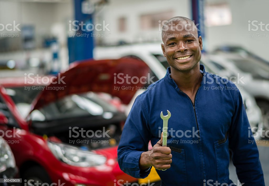 Mechanic holding tools stock photo