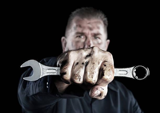 Mechanic holding wrench stock photo