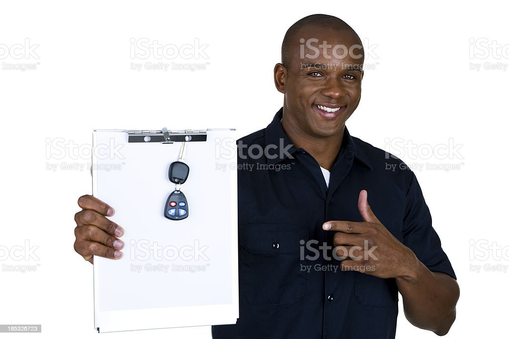 Mechanic holing clipboard with keys stock photo