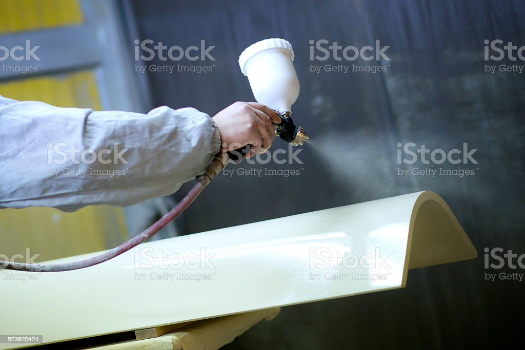 Mechanic How Spraying Wooden Part of Furniture stock photo