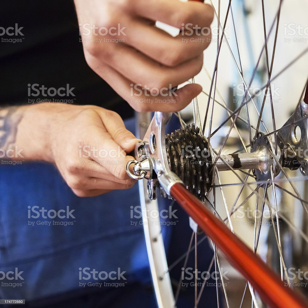 Mechanic in a Bike Store stock photo