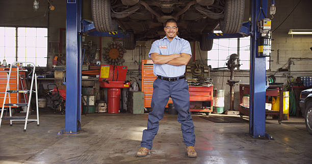 A mechanic in a large repair shop stock photo