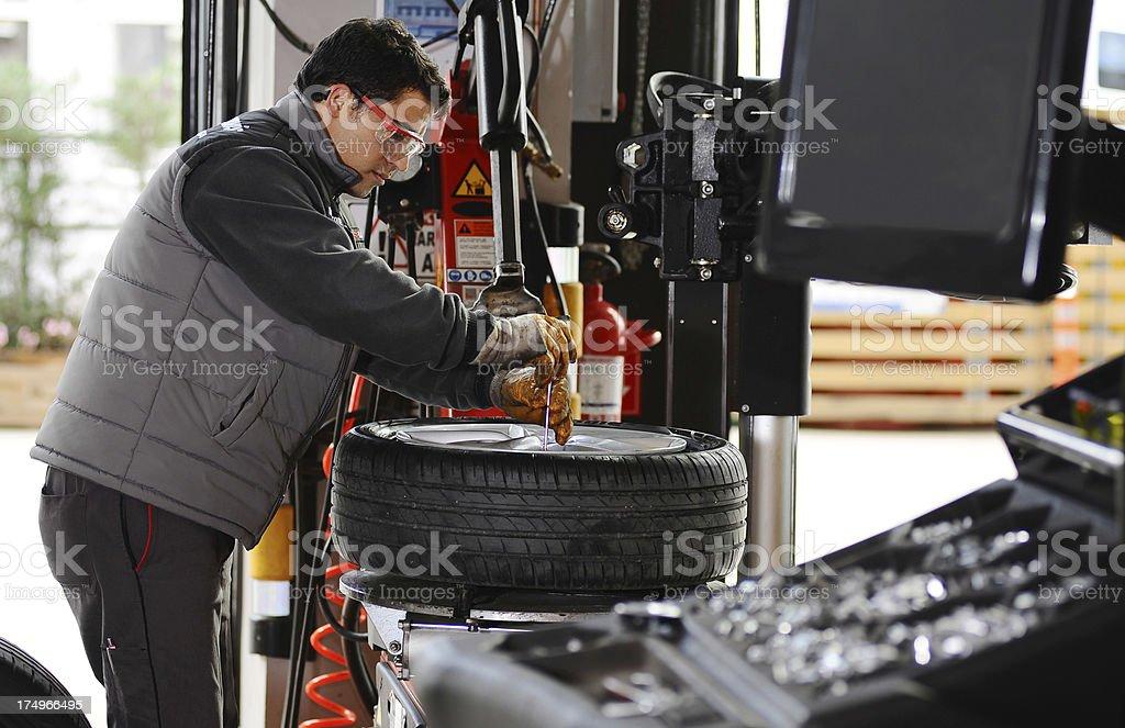 Mechanic in car repair shop stock photo