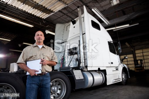 istock Mechanic in garage with semi-truck 175412254