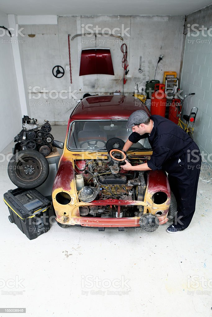 Mechanic in his garage. stock photo
