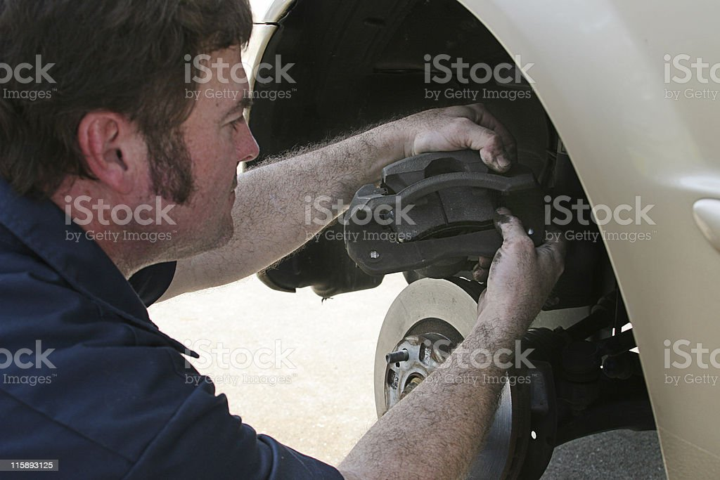 Mechanic Inserting Brake Pad stock photo