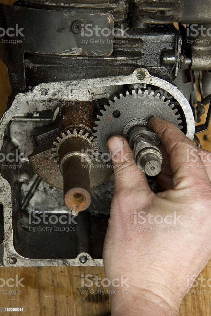 Mechanic Installs Timing Gear Shaft in Small Engine royalty-free stock photo