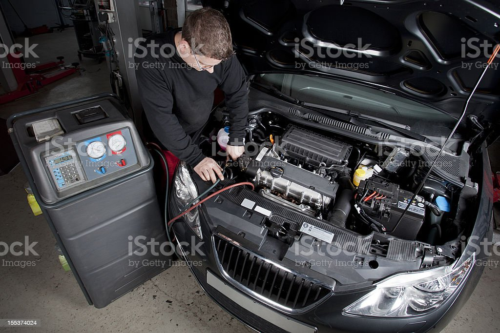 Mechanic is checking the engine of a modern car stock photo
