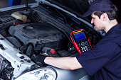 istock Mechanic is repairing vehicle at car service station 1167987982