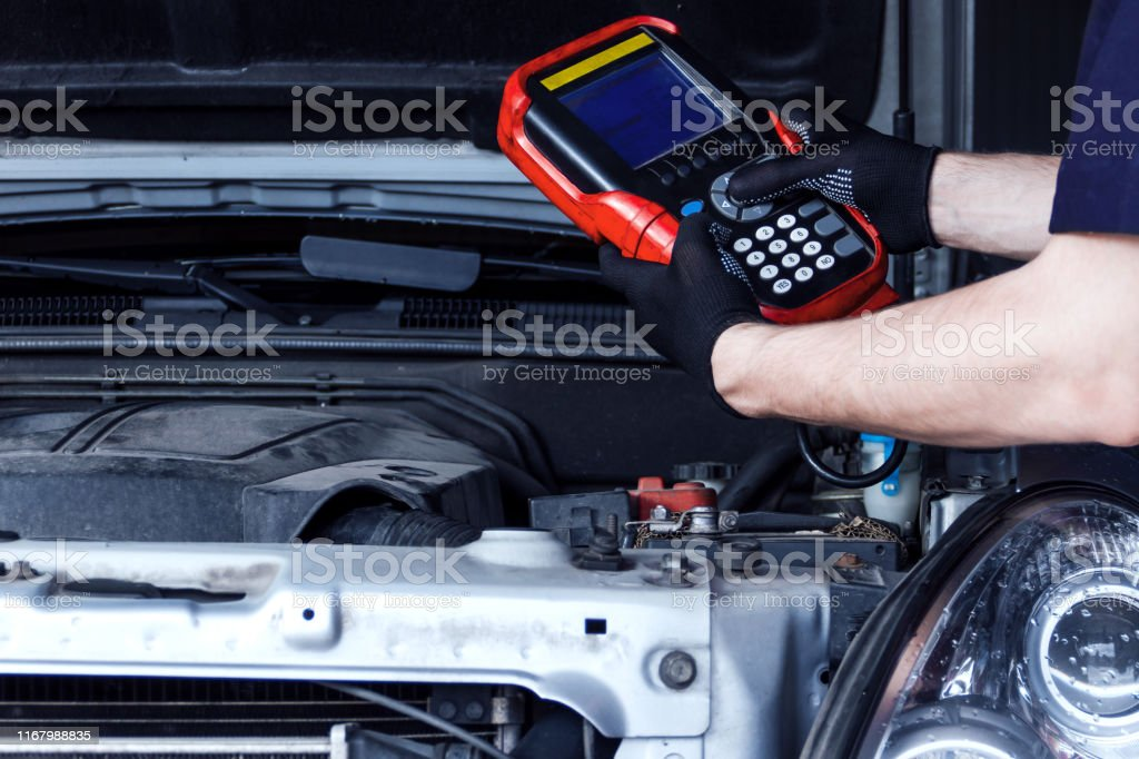 Mechanic Is Repairing Vehicle At Car Service Station Stock Photo Download Image Now Istock