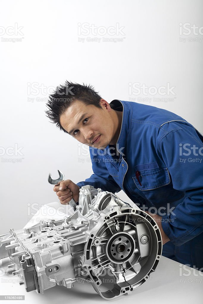 Mechanic is working with an engine royalty-free stock photo