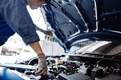 istock Mechanic man examining and maintenance via insurance system fix the engine a vehicle car hood, Safety inspection before customer drive on a long journey, transportation repair garage service center 1192845957