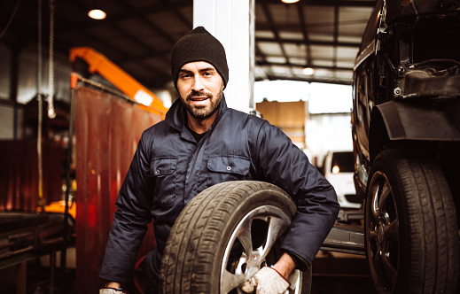 mechanic man repair a tire