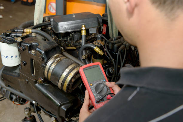 mechanic man with digital multimeter testing ignition coil stock photo