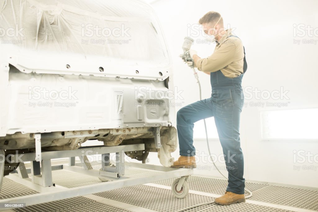 Mechanic Painting Car Body - Royalty-free Adult Stock Photo