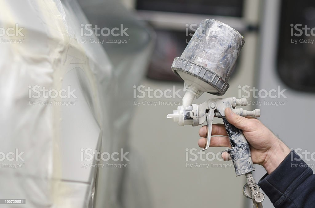 Mechanic Painting the Car in Auto Repair Shop royalty-free stock photo