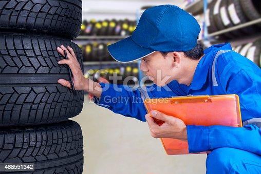 1047558948 istock photo Mechanic person examining tires 468551342
