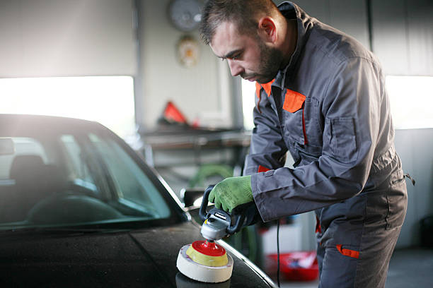mechanic polishing car. - auto body repair stock photos and pictures