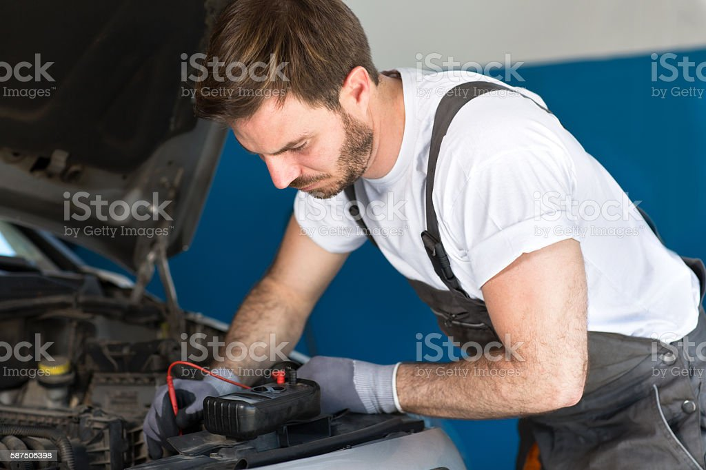Mechanic repair electronics accumulator stock photo