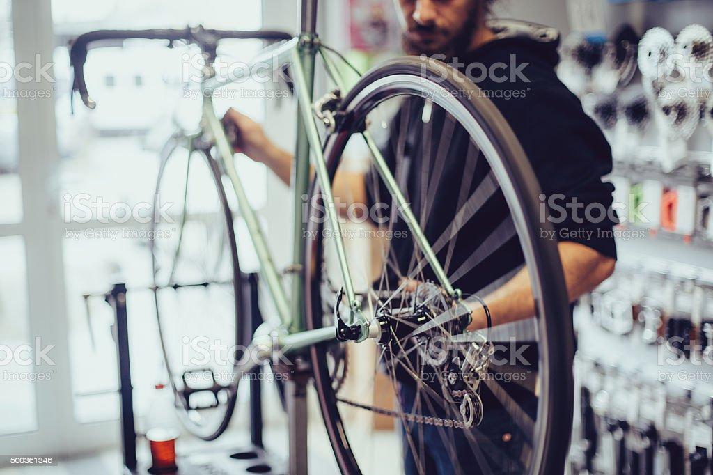 Mechanic repairing a bike stock photo