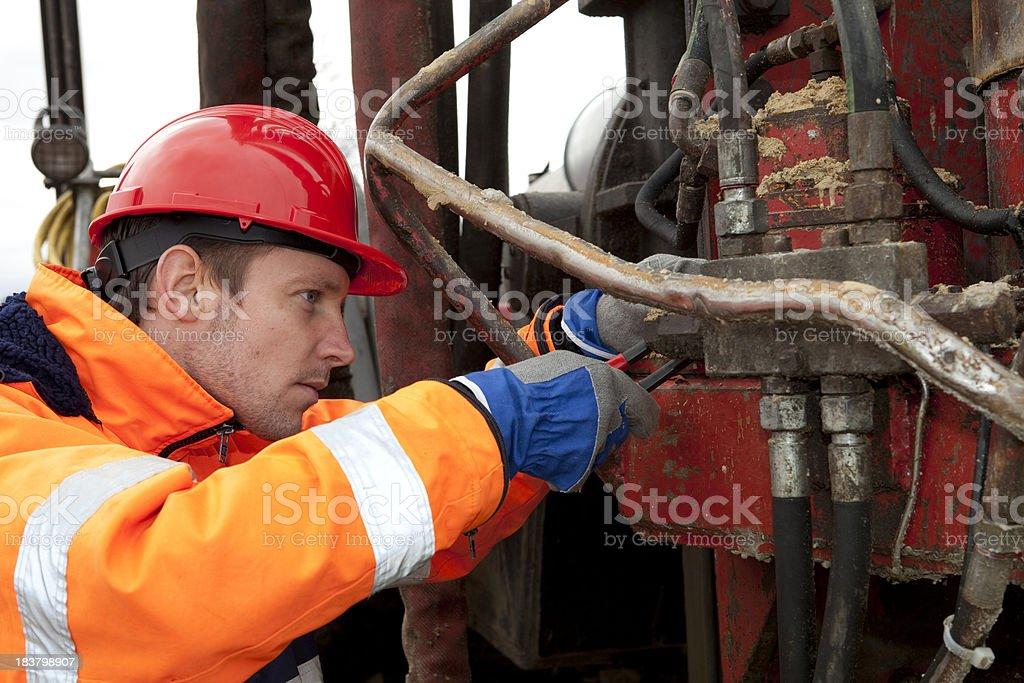 Mechanic repairing a machine. royalty-free stock photo