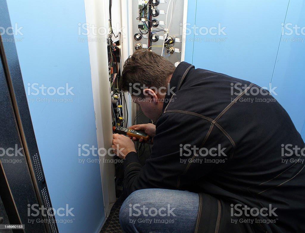 mechanic repairing button royalty-free stock photo