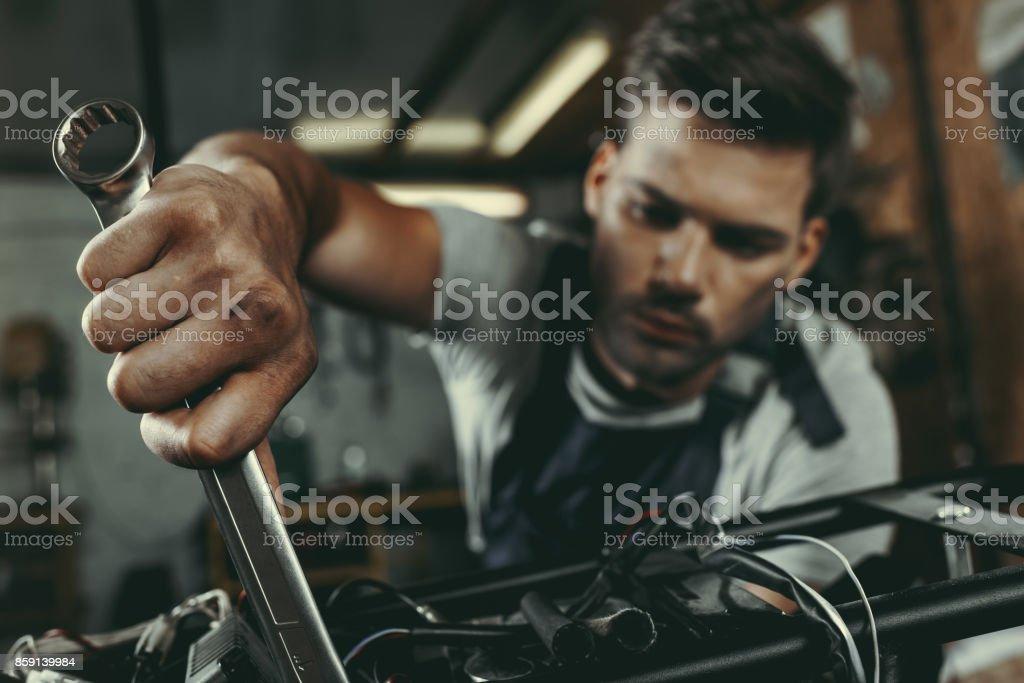 mechanic repairing motorbike stock photo