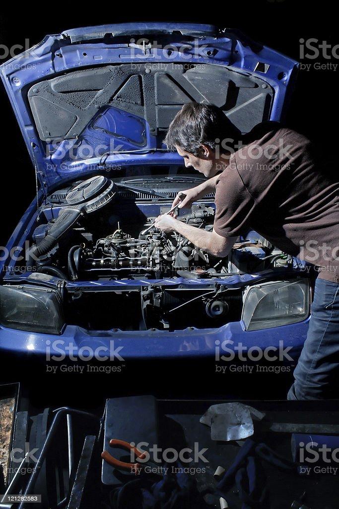 Mechanic repairing old car royalty-free stock photo