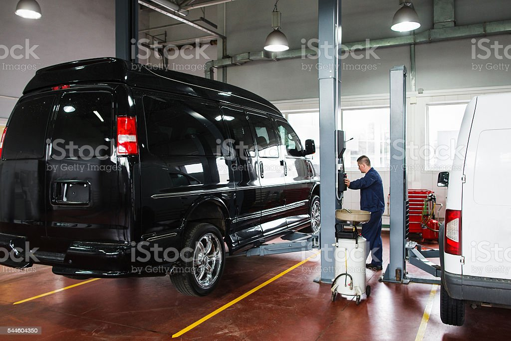 Mechanic Rising Car On Lift Before Maintenance Stock Photo ...