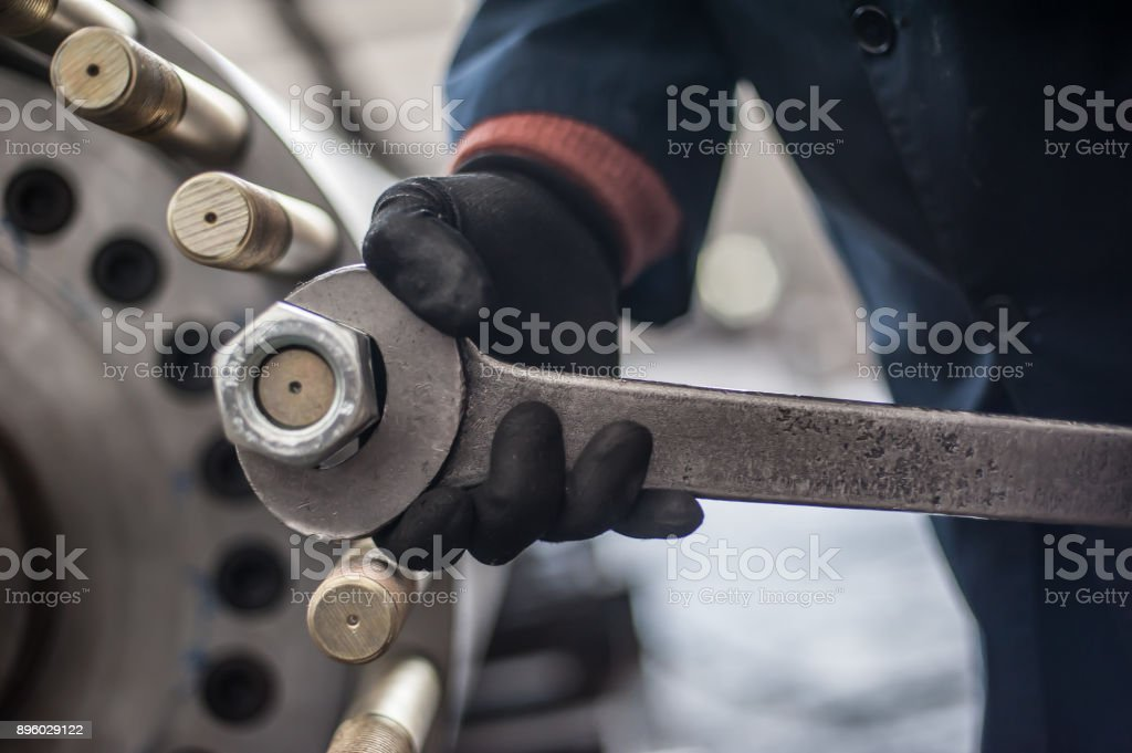Mechanic screws big bolt with large and heavy wrench key stock photo