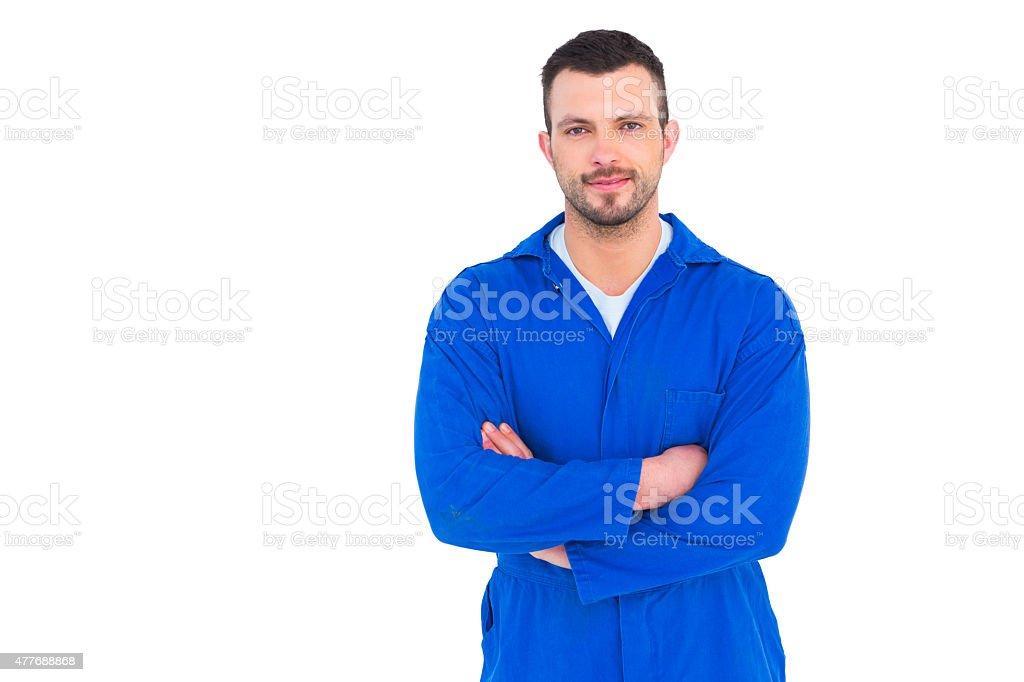 Mechanic standing arms crossed stock photo