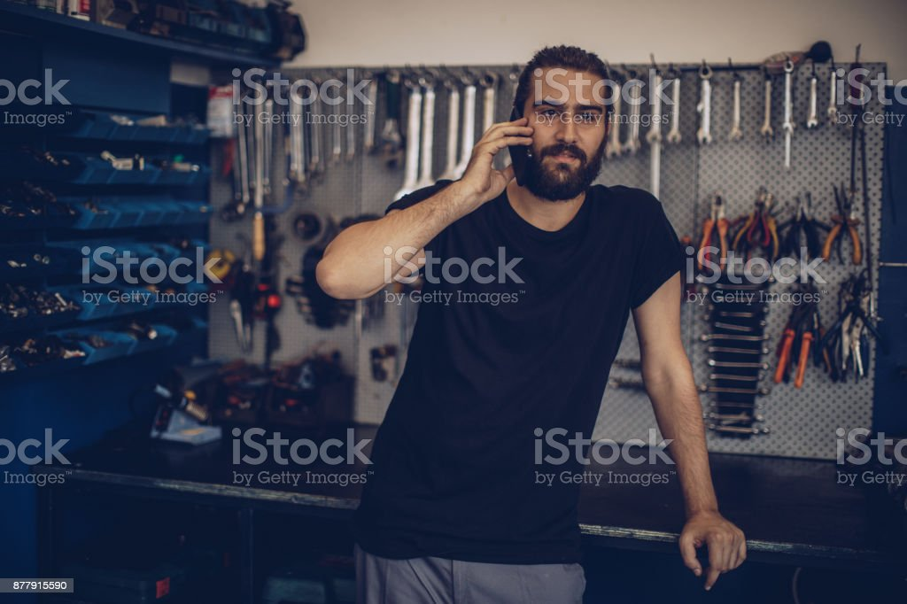 Mechanic talking on mobile stock photo
