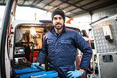 istock mechanic technician on a garage 621914182
