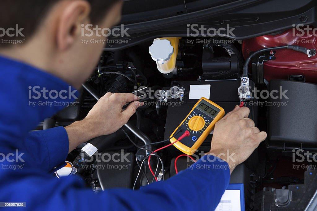 Mechanic Testing Car Battery stock photo