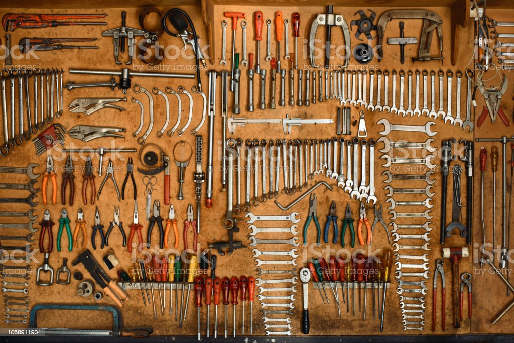 Mechanic tools arranged on the wall