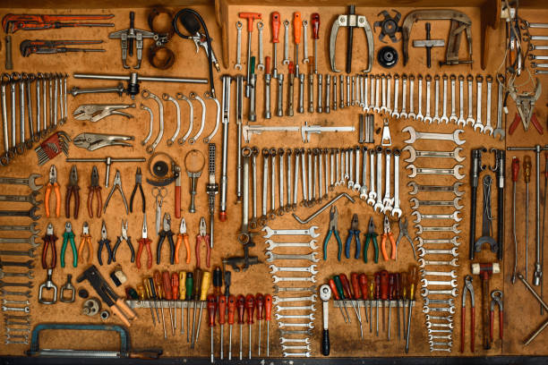 Mechanic tools arranged on the wall Mechanic tools arranged on the wall socket wrench stock pictures, royalty-free photos & images