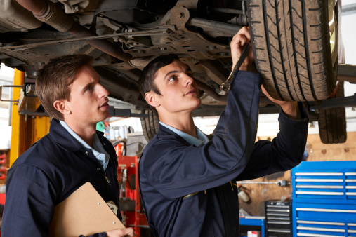 Mechanic Training A Student To Repair A Car Stock Photo ...
