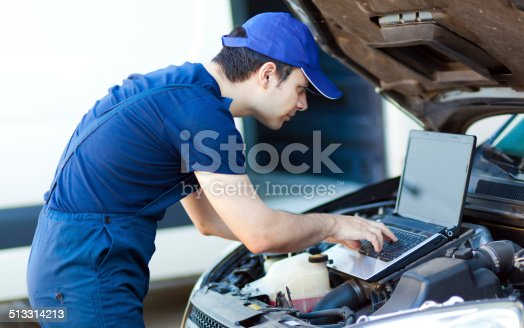 istock Mechanic using a laptop computer to check the car engine 513314213
