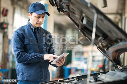 istock Mechanic using a tablet in his garage 470692506
