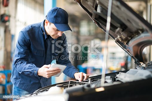 istock Mechanic using a tablet in his garage 486893690